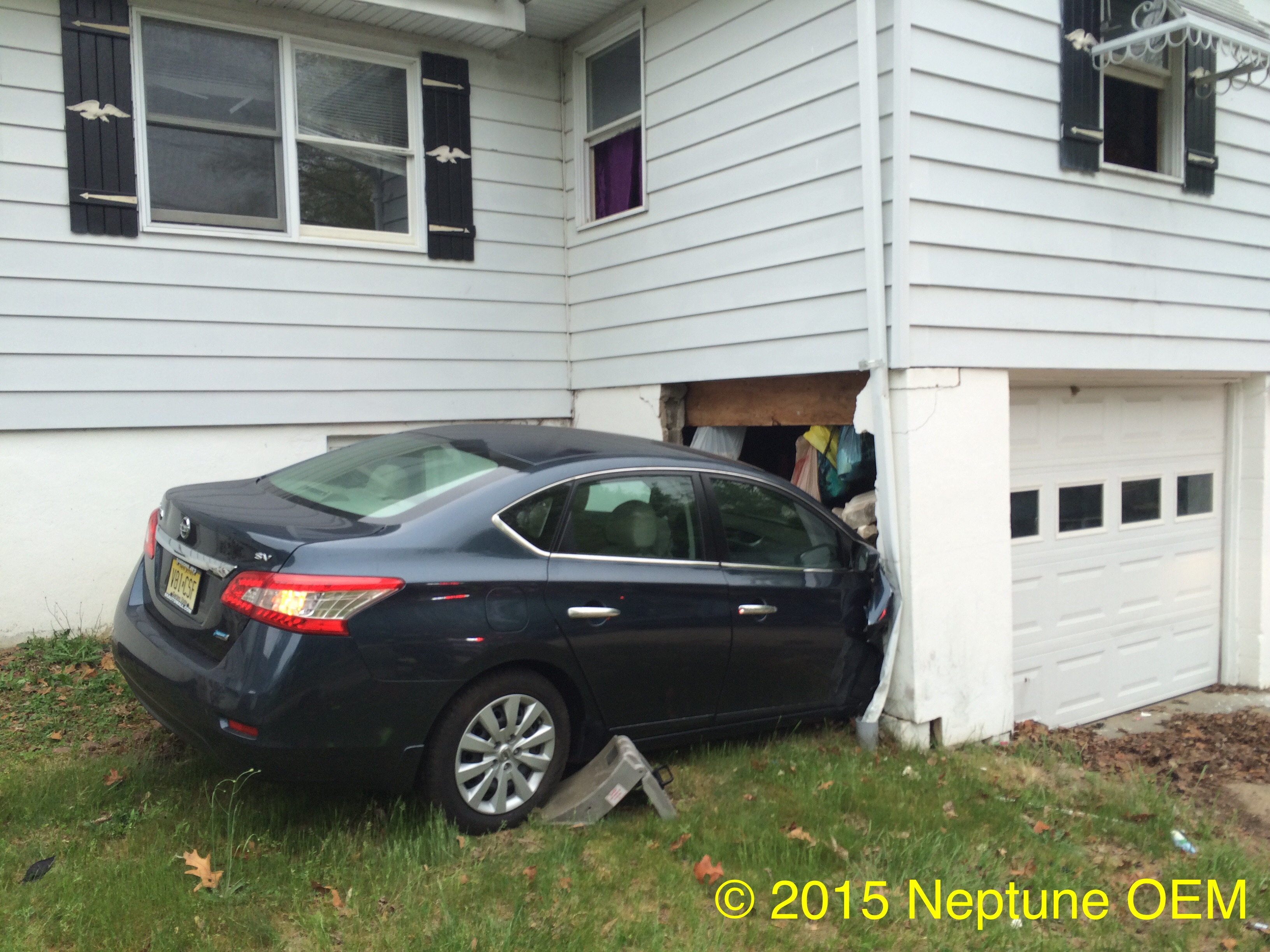 Car crashes into home in neptune township unexcelled for Car house